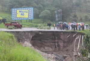 Highway Inter-Americana damaged by rain and mudslides.